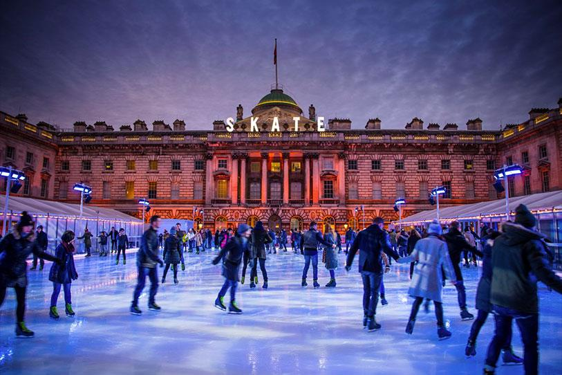 People ice skating outside of Somerset House