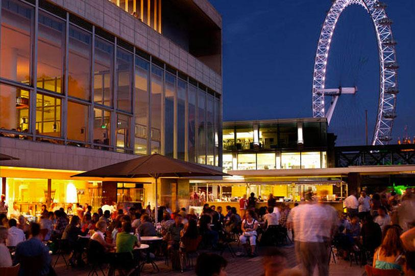 Southbank Centre shown at night with the London Eye in the background